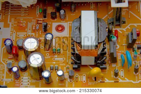 The electronic board with parts  a electrical background