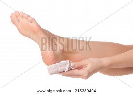 Female feet heel stone pumice on white background isolation