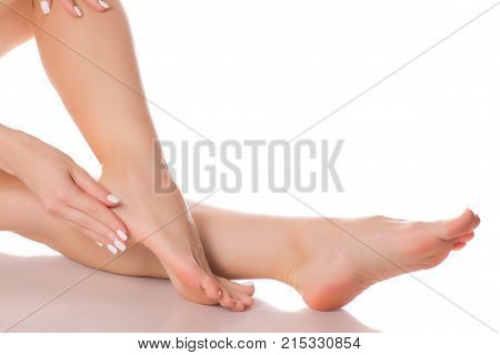 Female feet heel beauty medecine on a white background isolation