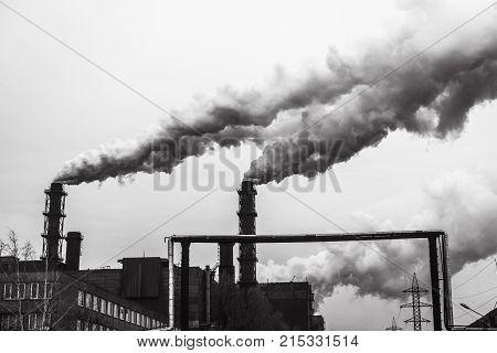 mining enterprise with smoke stacks. Dirty smoke on the sky ecology problems.