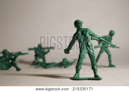 A small toy soldier with his companions