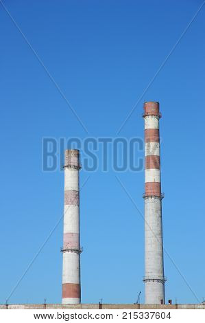 Factory pipe on a background of blue sky