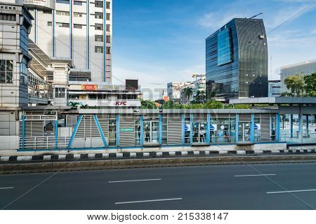 Jakarta, Indonesia - November 2017: Transjakarta bus station in central Jakarta. Transjakarta is the first BRT (Bus Rapid Transit) system developed in South and South East Asia.