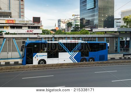Jakarta, Indonesia - November 2017: Transjakarta bus in downtown Jakarta. Transjakarta is the first BRT (Bus Rapid Transit) system developed in South and South East Asia and operates in Jakarta.