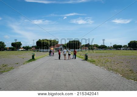 Yogyakarta, Indonesia - October 2017: Green Square in front ofKraton Palace, the royal grand palace in Yogyakarta, Indonesia. Kraton Palace is a landmark and popular tourist destination in Yogyakarta.