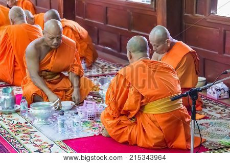 Monks In Merit Making