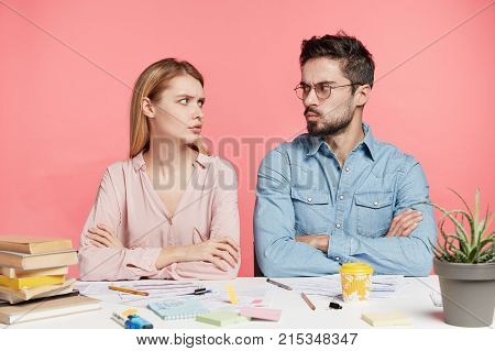 Two Female And Male Students Have Disagreement, Keep Hands Crossed, Looks At Each Other Angrily, Can