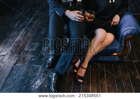 Couple clinking glasses with alcohol on their date. Man trying to make woman drunk to have sex. No-string attached relationships concept