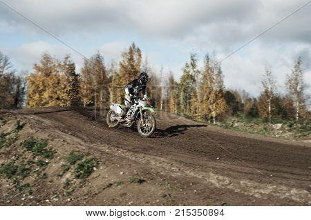 Motocross Rider On Race Track