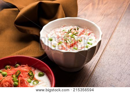 Carrot raita Gajar  Koshimbir. It a condiment from the Indian subcontinent, made with dahi curd together with raw  cooked vegetables Gajar Carrot, green, peas, chili, coriander