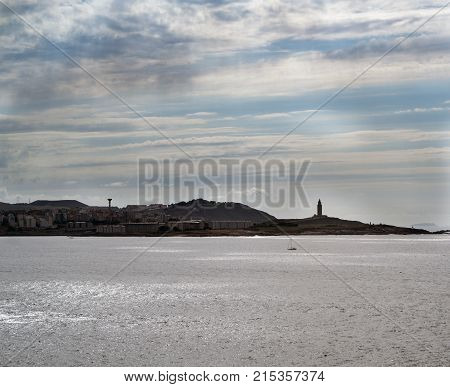 Image Of The Coast And Sky Line Of La Coruna (spain) With The Tower Of Hercules Standing Out In The