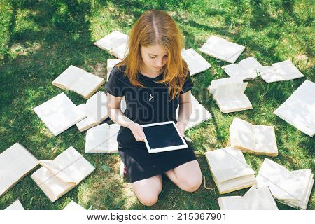 Woman Learning With Ebook Reader And Book. Choice Between Modern Educational Technology And Traditio