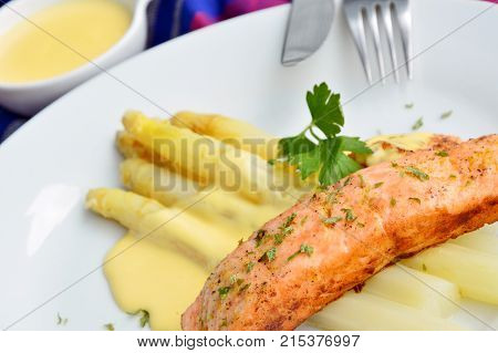 Asparagus with salmon and hollandaise sauce (German name is Spargel mit Lachs und Sauce Hollandaise)