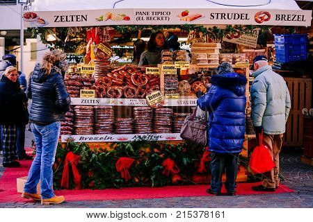 TRENTO ALTO ADIGE ITALY - DECEMBER 17 2016: pretzels strudel and others typical products at the traditional Christmas market. Alto Adige Italy