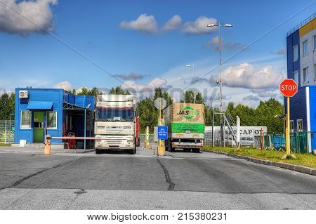 St. Petersburg Russia - July 27 2017: Two trucks stand at the security checkpoint.