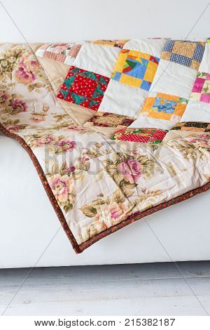 neat loud-coloured covering with pattern from abstract images and outstanding prints of red roses and white chamomile