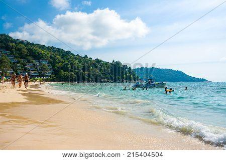 Phuket, Thailand - February 6, 2017: Tourists on the Kata Noi beach - one of the best beaches in Phuket