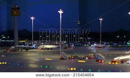 HAMBURG, GERMANY - MARCH 8th, 2014: Flughafen Wunderland. Up to 40 different aircrafts, from Cessna to Airbus A 380, are taxing independently on Knufingen Airport at Miniatur Wunderland Museum to the gates.