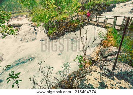 Tourist On River Bridge, Norway