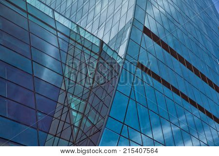 Building glass . Clouds Reflected in Windows of Modern Office Building.