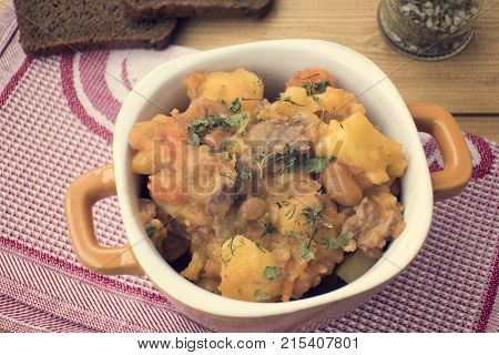 stewed vegetables with beans and meat hearty food
