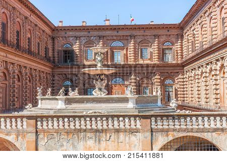 The facade of Palazzo Pitti and the fountain Florence in Italy