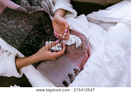 the girl fell ill with angina because of cold winter weather, drinks tablets, sore throats