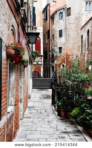 A quiet alley in Venice void of people.