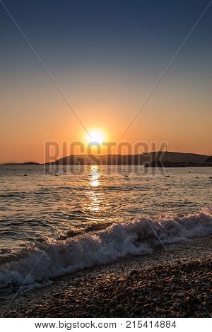 Sunset and waves at the beach of Turkey