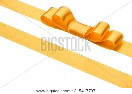 Festive golden gift ribbon and bow isolated on white background cutout