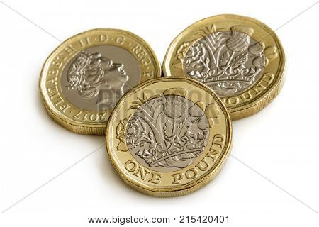 New British one pound coins, isolated on white background.