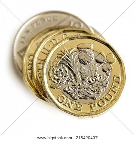Stack of British coins, top view, isolated on white.