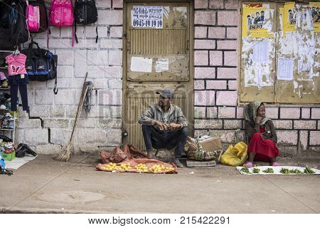 ADDIS ABABA, ETHIOPIA-OCTOBER 25, 2017: Unidentified street sellers sell fruits and peppers in the capital of Ethiopia, Addis Ababa.