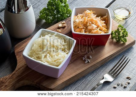 Fermented Cabbage And Carrots In Two Square Bowls On A Table