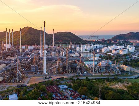 Aerial view Oil refinery.Industrial view at oil refinery plant form industry zone with sunrise and cloudy sky.Oil refinery and Petrochemical plant at duskThailand. Oil refinery background sunset