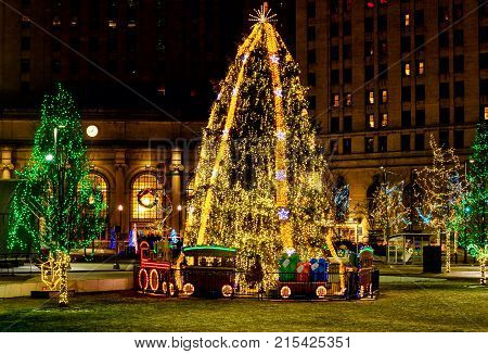 CLEVELAND OH - DECEMBER 30 2016: A dazzling Christmas tree stands amid other holiday lighting displays on Public Square in downtown Cleveland.