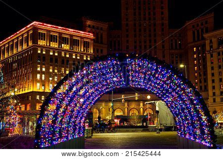 CLEVELAND OH - DECEMBER 30 2016: A brightly colored tunnel of lights stands among the Christmas lighting displays on Cleveland's Public Square
