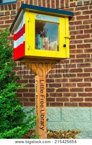GOODLETTSVILLE TN - AUGUST 22 2017: A Little Free Library exchange box stands next to a public building. Little Free Library promotes free sharing of books in exchanges all over the country
