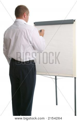 Businessman Writing On A Flip Chart.