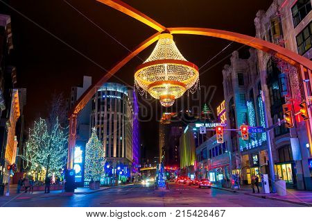 Cleveland OH - Jan 1 2016: Playhouse Square is lit up for Christmas with the giant Chandelier prominently suspended above Euclid Avenue.
