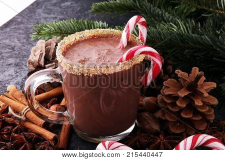 Traditional Christmas drinks. North Pole Cocktail with candy cane sweets peppermint hot chocolate or cocoa ginger ad milk