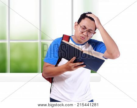 Young Male Student Worried When Reading Exam Report