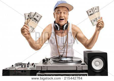 Joyful elderly DJ holding bundles of money isolated on white background