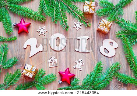 New Year 2018 background with 2018 figures Christmas decorations and fir branches. New Year 2018 still life. Festive New Year 2018 composition. Holiday postcard with Happy New Year 2018 concept