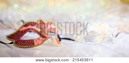 Pink Carnival Mask On Bokeh Background