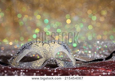 Silver Carnival Mask On Bokeh Background