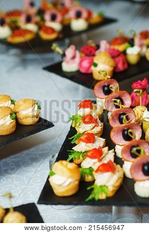 Catering during events. Banquet and snacks for guests and participants of the event. Fresh canaps and snacks on the table. Soft focus.