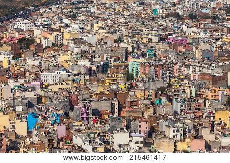 Aerial view on chaos of colored buildings - the heap of houses in the Asian cities caused by big human overpopulation.