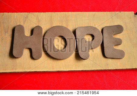 word hope on  an  abstract colored background