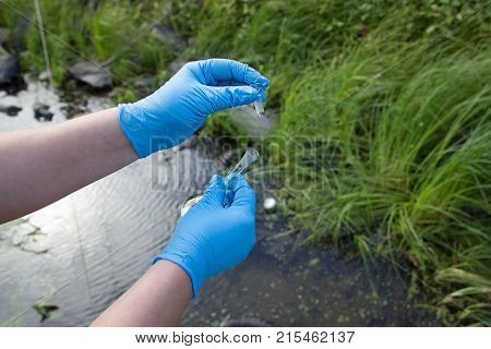 A water sample from the river. Water intake. Water abstraction. Water diversion.
